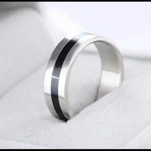Other - Black and silver stainless steel band ring